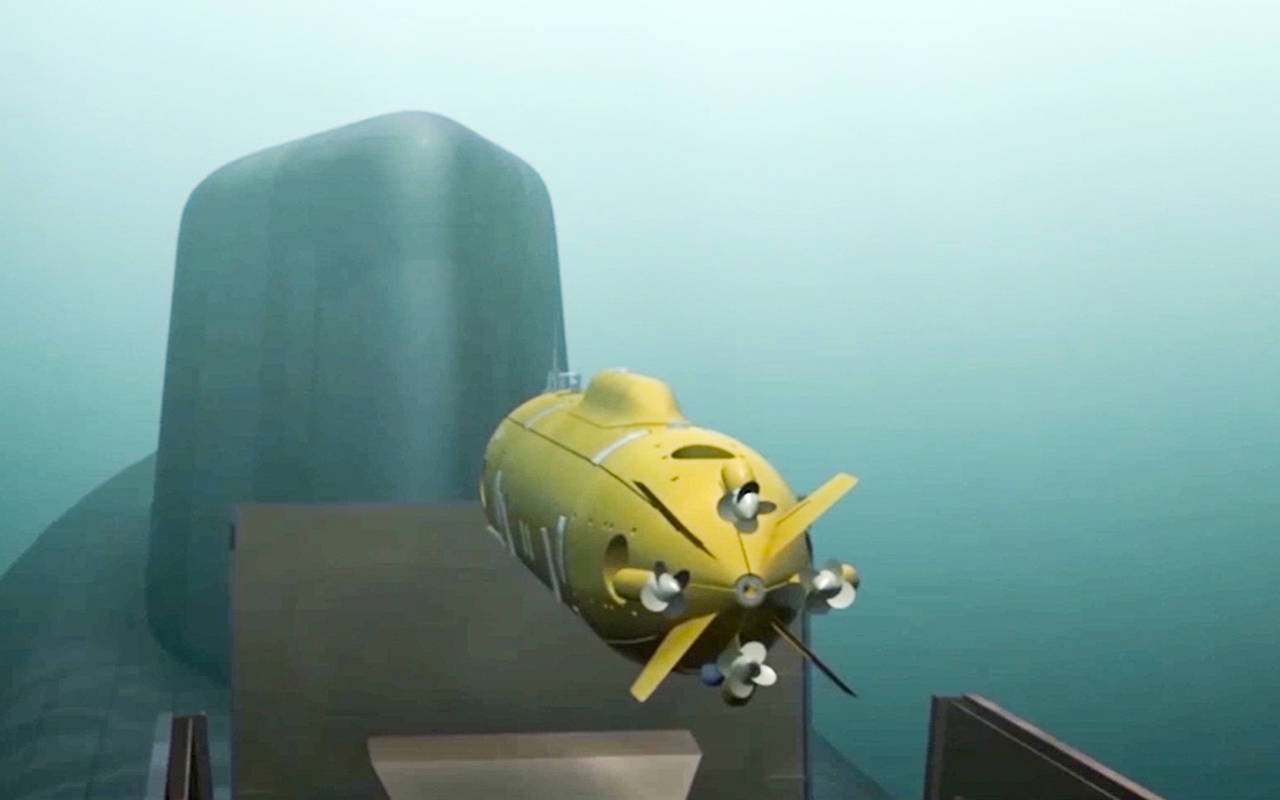 In this March 1 video grab, a computer simulation shows a Russian nuclear-powered underwater drone being released by a submarine. (RU-RTR Russian Television via AP)