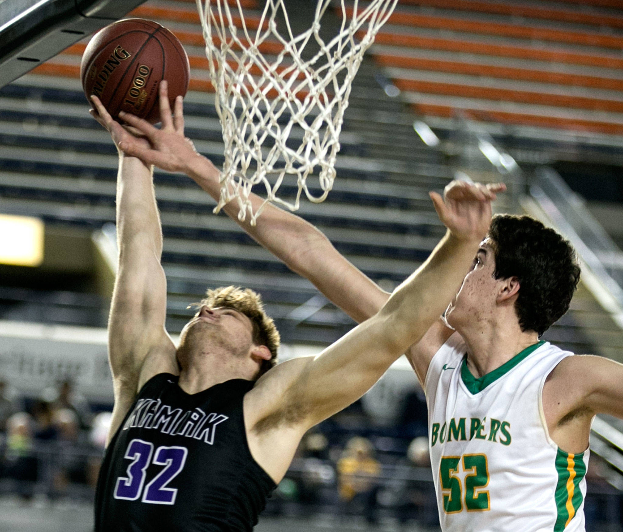 Kamiak's Braden Leary has his shot blocked by Richland's Riley Sorn during a 4A boys Hardwood Classic game on March 1, 2018, at the Tacoma Dome. (Kevin Clark / The Herald)