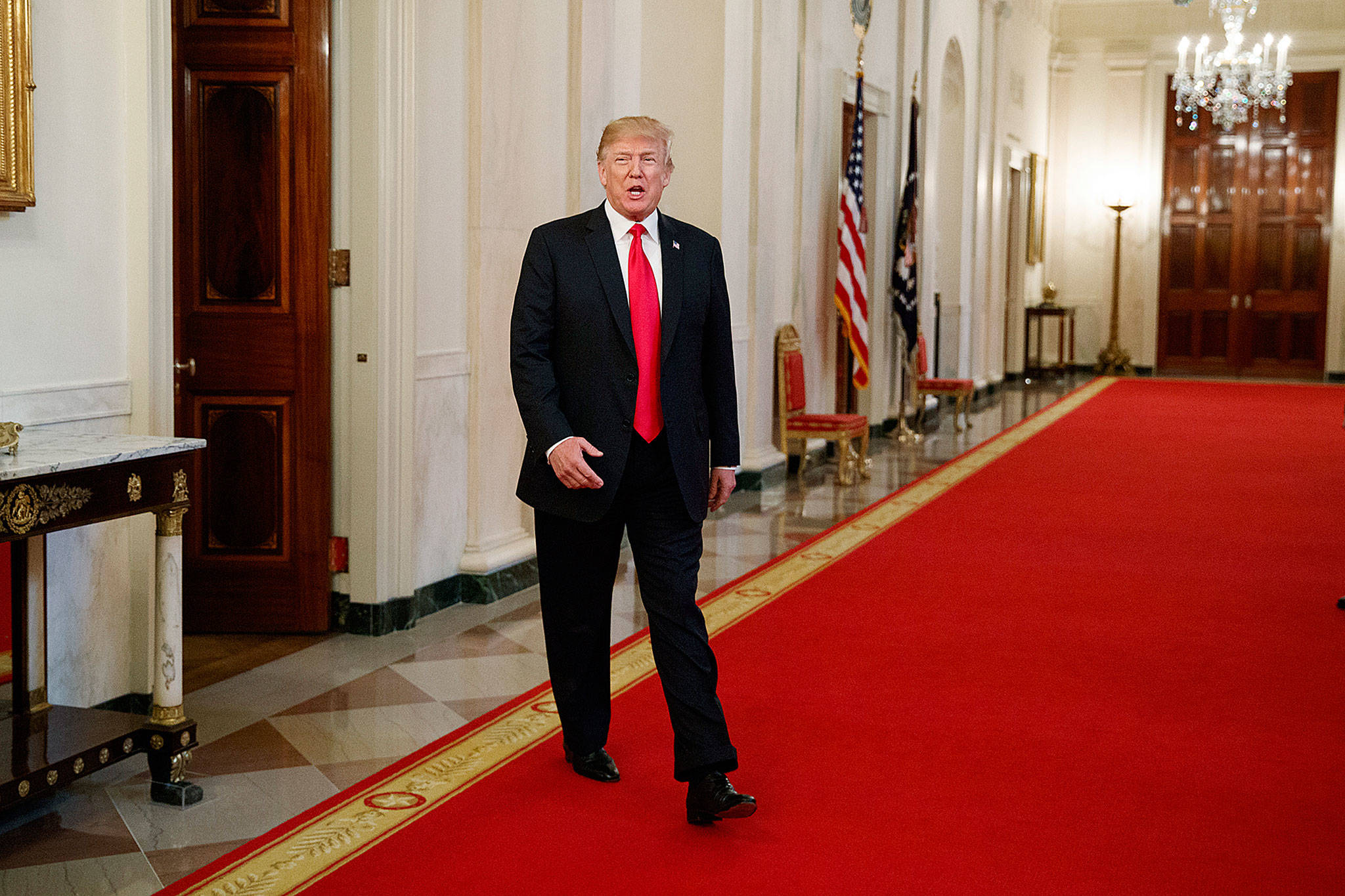 President Donald Trump arrives to speak to the White House Opioid Summit in the East Room of the White House on Thursday. (AP Photo/Evan Vucci)