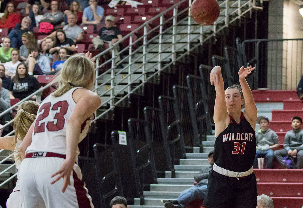Archbishop Murphy's Audrey Graham (31) hits a wide open 3-point shot against W.F. West in the 2A girls Hardwood Classic championship game on March 3, 2018, at the Yakima Valley SunDome. W.F. West defeated Archbishop Murphy 64-52. (TJ Mullinax / For The Herald)