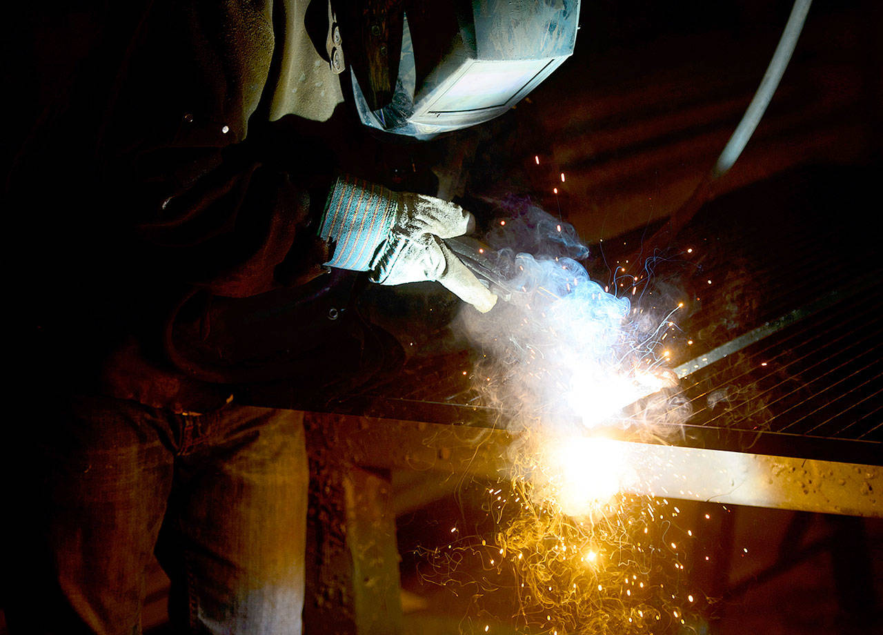 A welder fabricates a steel structure at an iron works facility in Ottawa, Ontario, on Monday. (Sean Kilpatrick/The Canadian Press via AP)