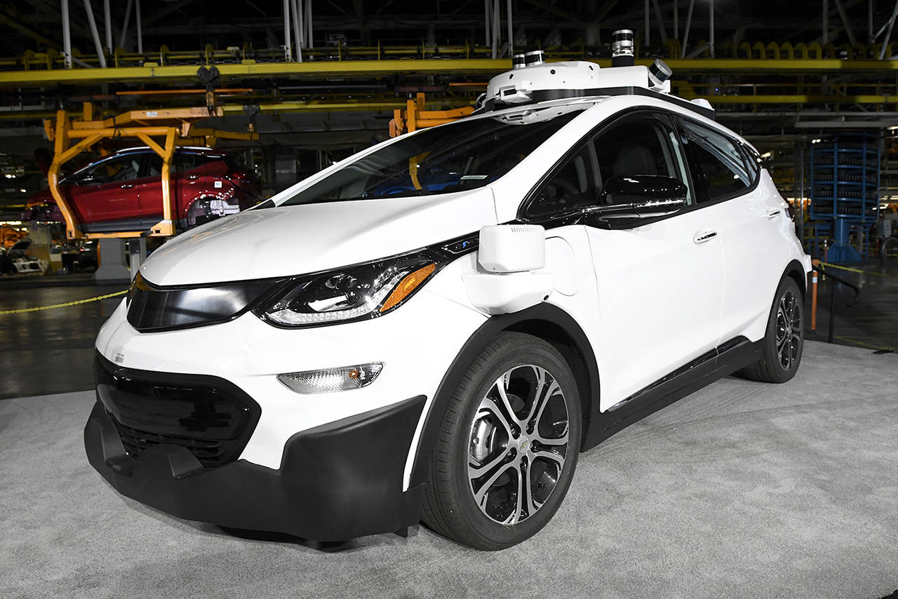 A self-driving Chevrolet Bolt EV that is in General Motors Co.'s autonomous vehicle development program appears on display at GM's Orion Assembly in Lake Orion, Michigan. (Jose Juarez/Detroit News via AP, File)