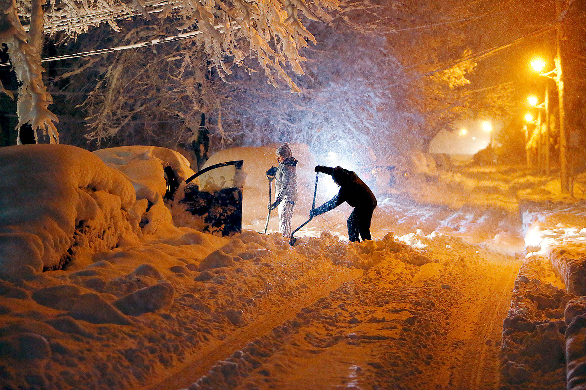Residents dig out their car after a snowstorm dumped over a foot of snow Wednesday in Morristown, New Jersey. (Bob Karp/The Record via AP)