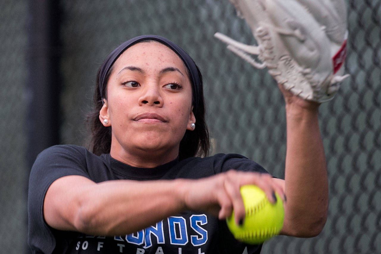 Seli Aholelei throws a pitch during a recent practice at Edmonds Community College. (Kevin Clark / The Daily Herald)