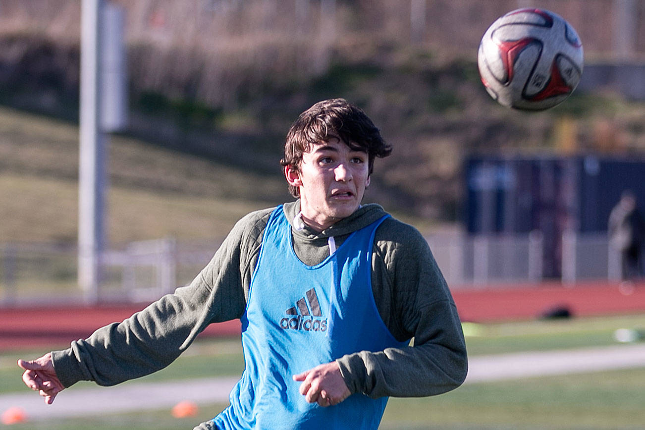 Keegan Rubio runs through drills during practice Friday afternoon at Glacier Peak High School in Snohomish on March 17, 2018. (Kevin Clark / The Daily Herald)