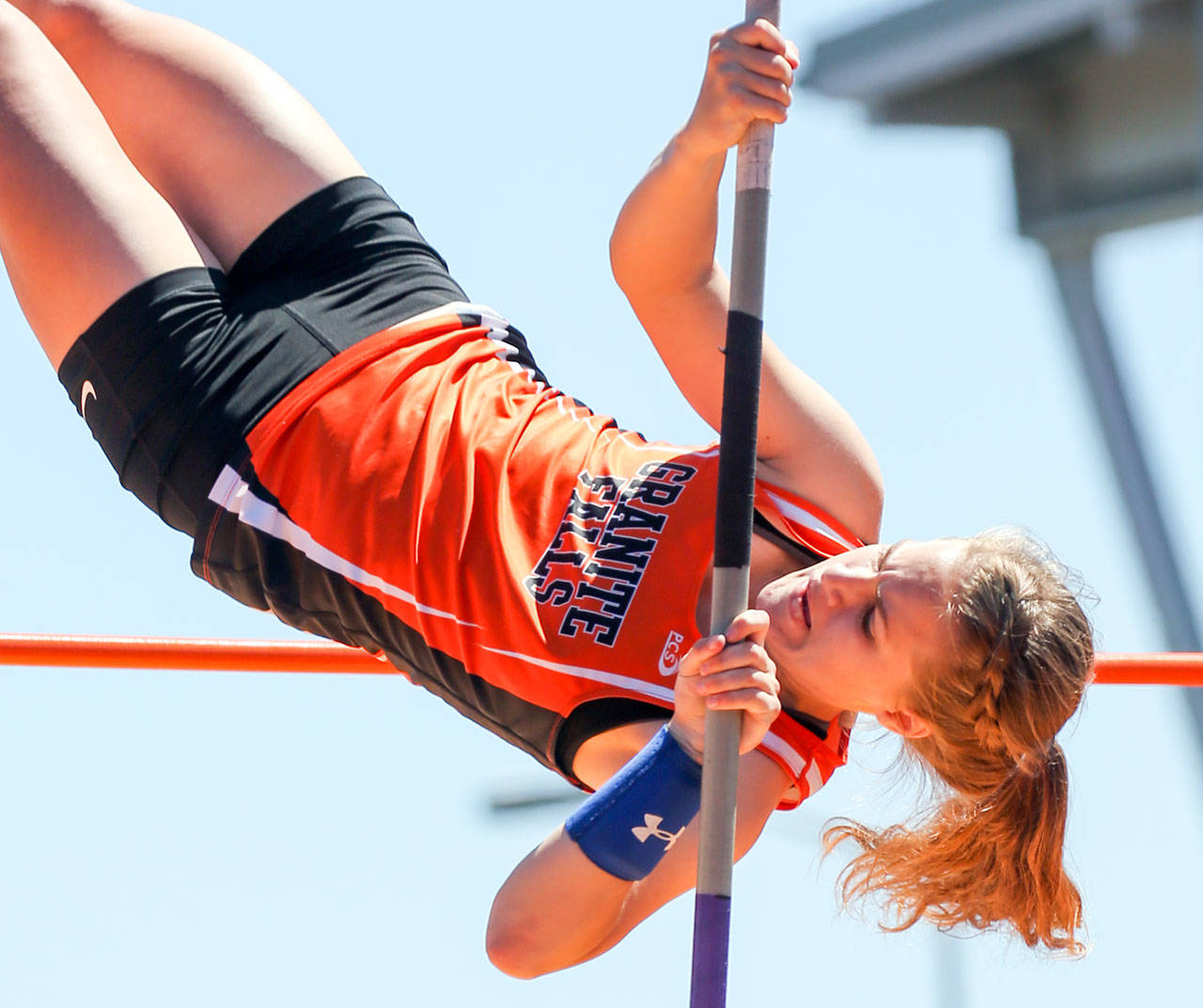 Kelsey Bassett of Granite Falls competes in the pole vault at the 2017 Class 2A state track and field championships in Tacoma last May. Bassett finished second in the event. (Kevin Clark / The Herald)                                Kelsey Bassett of Granite Falls competes in the pole vault at the 2017 Class 2A state track and field championships last May in Tacoma. Bassett finished second in the event. (Kevin Clark / The Herald)