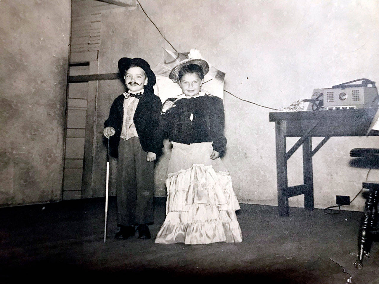 Dale and Charlene Reiner as children playing dress-up at the Tualco Grange in Monroe. (Family photo)