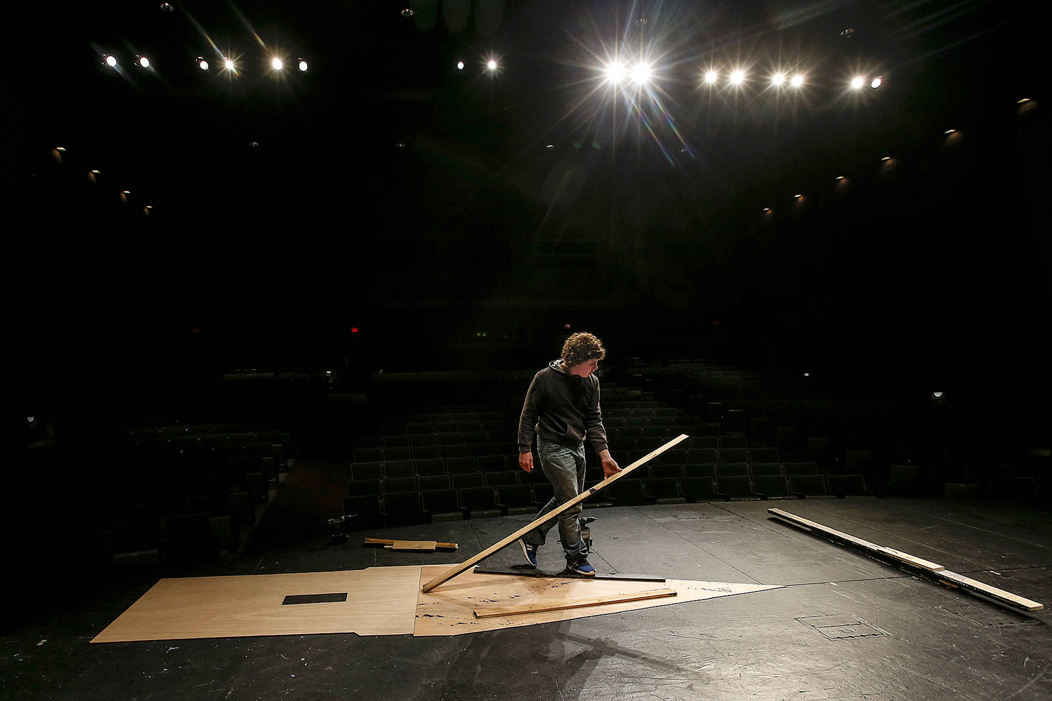 "The framework for a castle tower is laid out by a student preparing props for Kamiak High School's production of ""Spamalot"" on April 4. (Ian Terry / The Herald)"