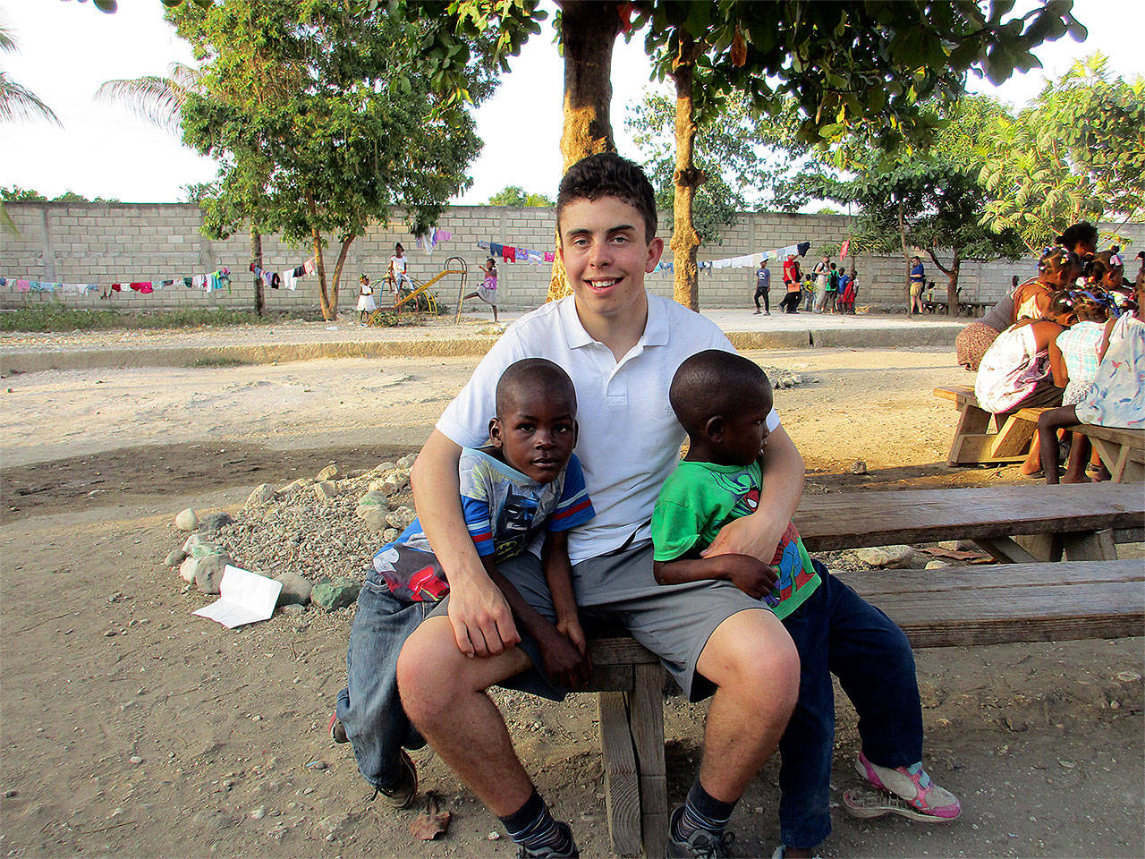 Snohomish High School senior Landon Strickland hangs out with some of the kids at a Haiti orphanage, among the spots he and eight other teens visited over their spring break for a service trip to deliver meals. (Contributed photo)