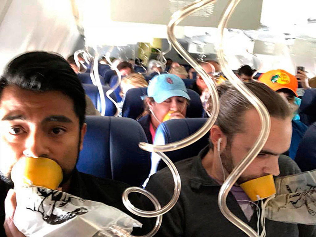 Marty Martinez (left) is seen with other passengers after the 737's window blew out on a flight from New York to Dallas. (Marty Martinez)