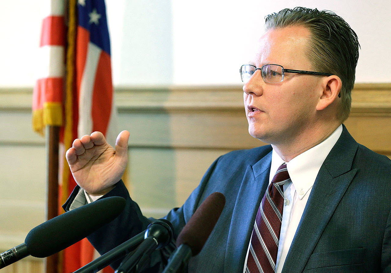 Chris Reykdal, Washington's superintendent of public instruction, talks to reporters last year in Olympia. (AP Photo/Ted S. Warren)