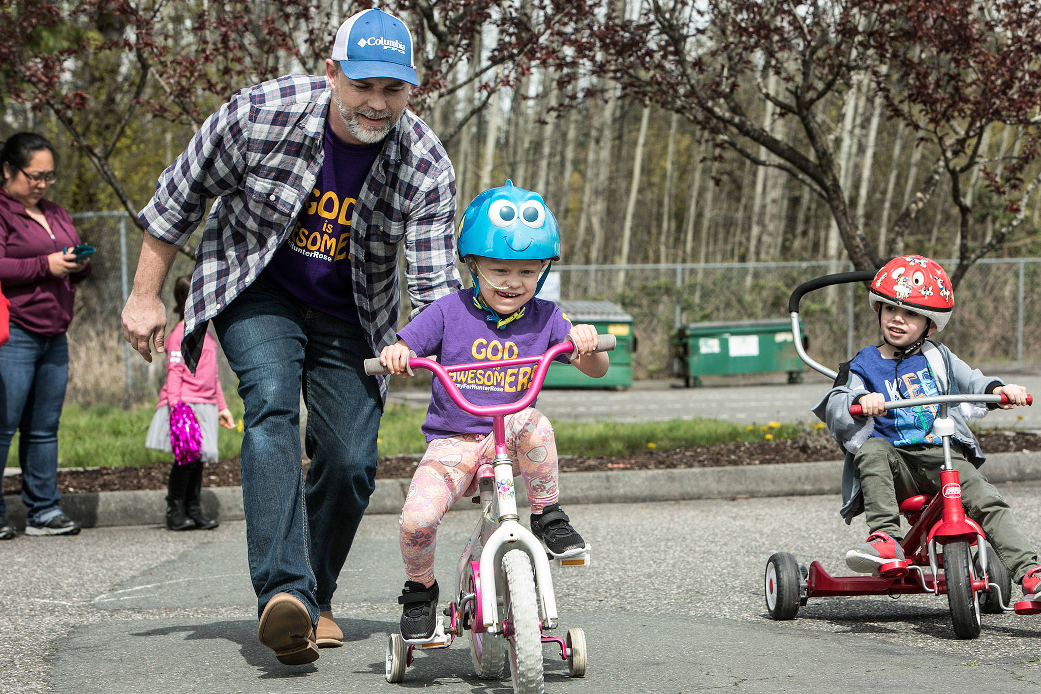 Hunter Rose Jones rides in the annual Prince of Peace Preschool trike-a-thon to raise money for Seattle Children's Hospital on April 19 in Everett. Hunter Rose was diagnosed with stage four neuroblastoma in September. (Lizz Giordano / The Herald)