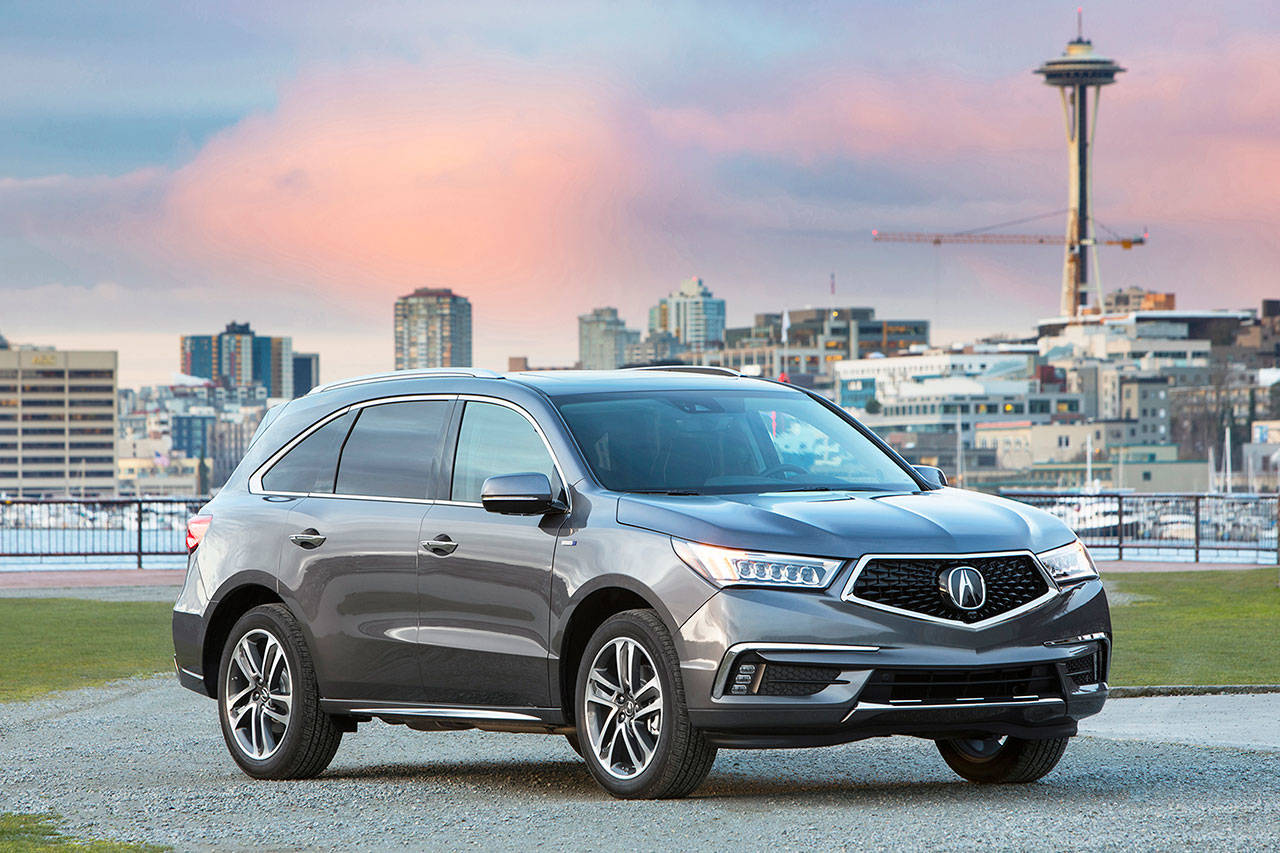 The three-row Acura MDX luxury midsize SUV has seating for up to seven passengers.