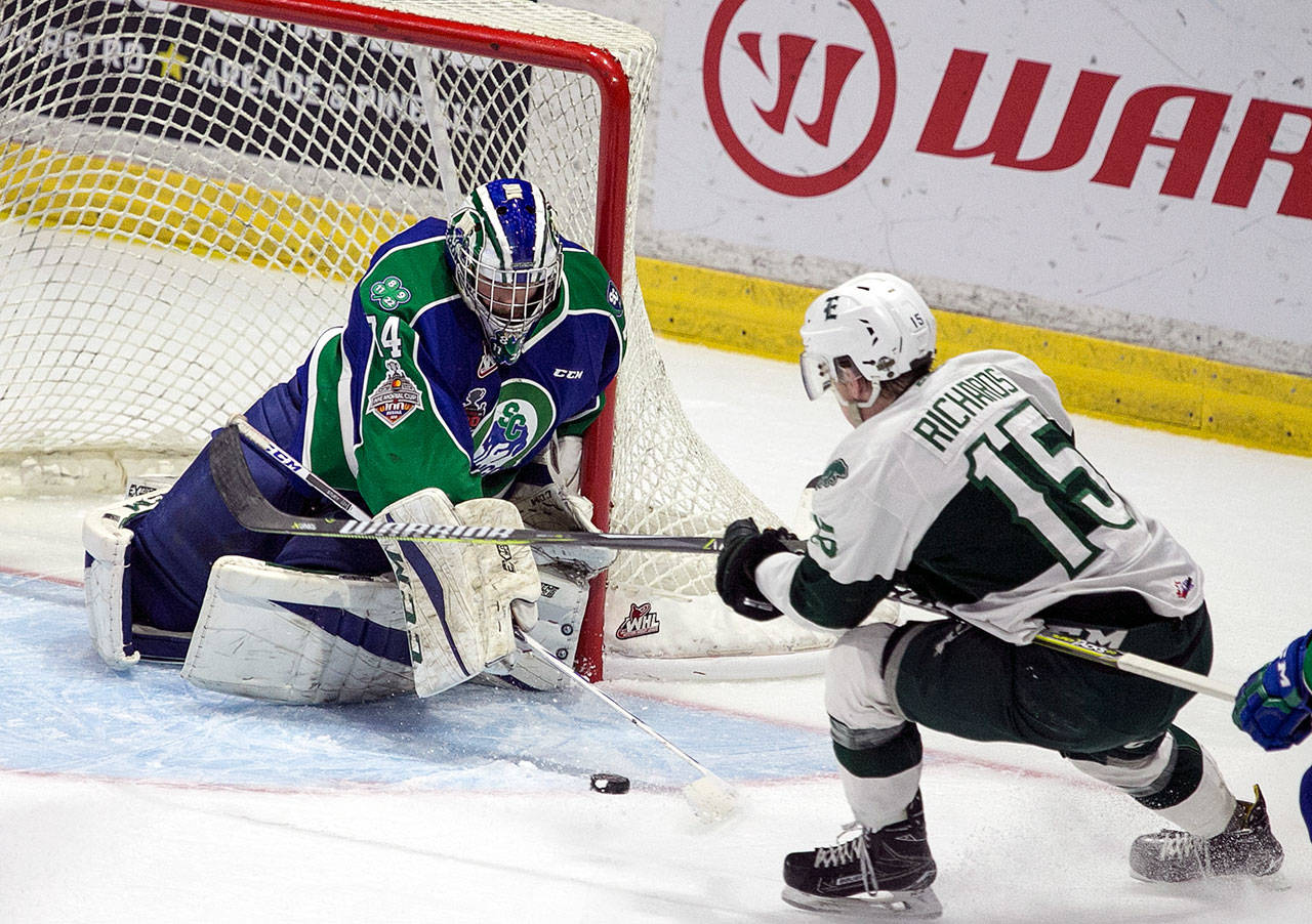 Swift Current goalie Stuart Skinner (left) defends against a shot attempt by the Silvertips' Sean Richards in the first period of Game 4 of the WHL finals on May 9, 2018, at Angel of the Winds Arena in Everett. (Kevin Clark / The Herald)