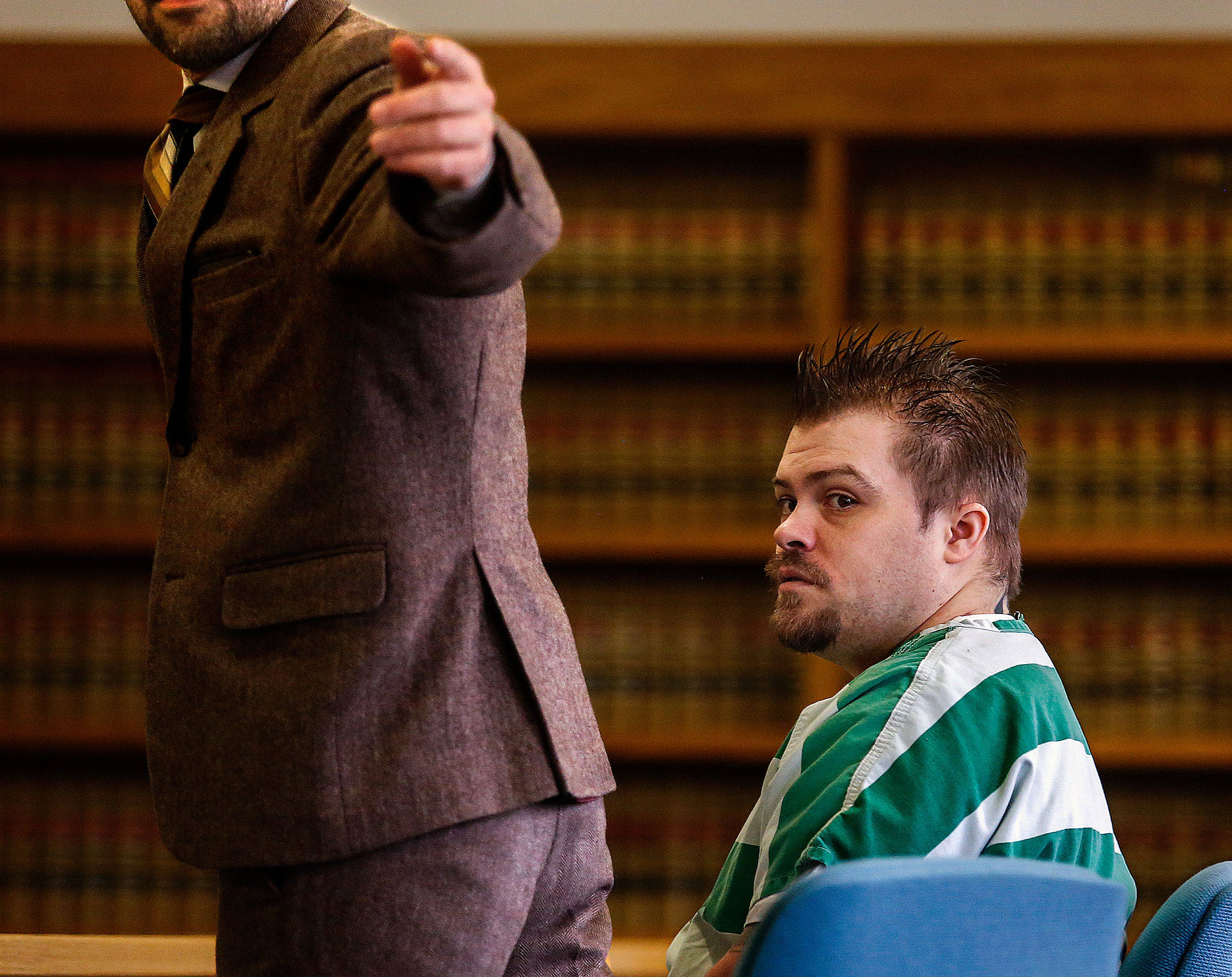 Public defender Jason Schwarz (left) directs a courtroom deputy as he and convicted violent rapist Daniel Miltenberger prepare to approach the bench during Miltenberger's sentencing hearing in February. (Dan Bates / Herald file)