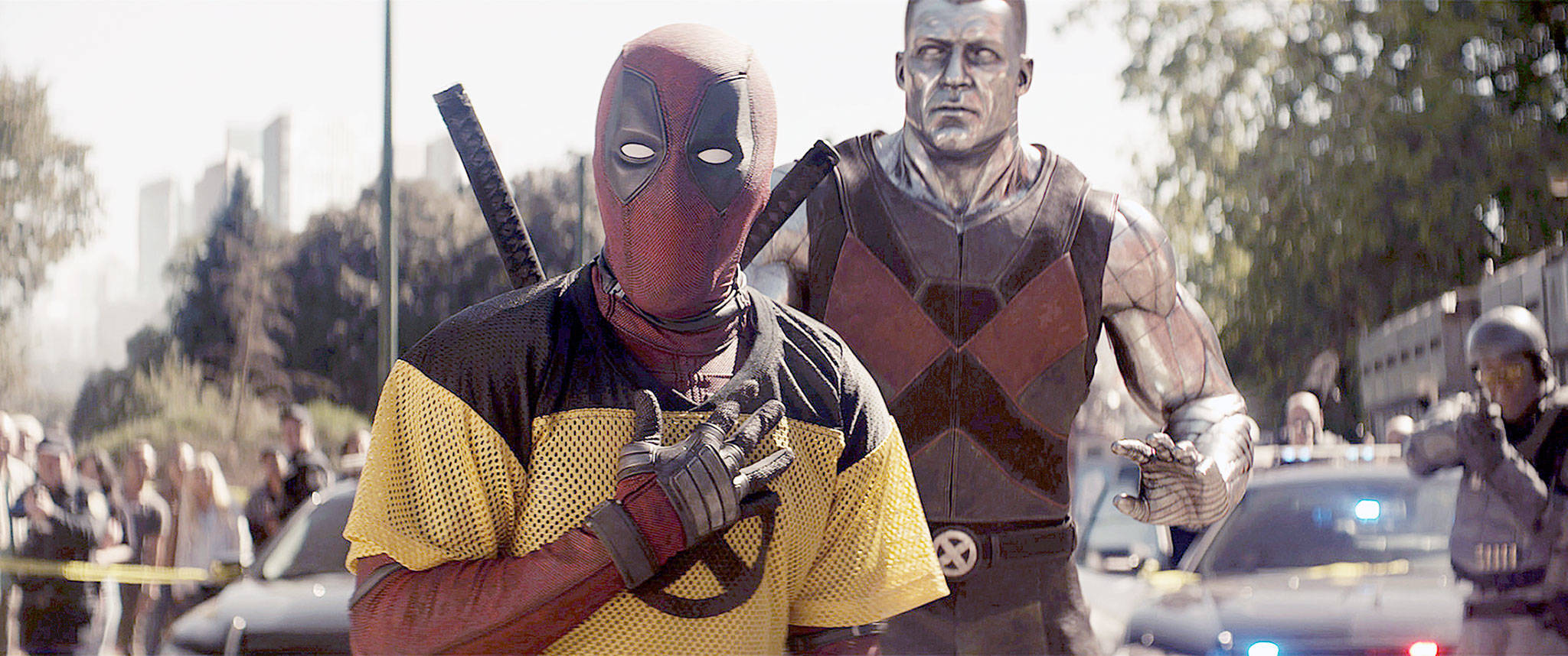 "The title character, Ryan Reynolds (left), and Colossus (voice of Stefan Kapicic) in the action-comedy sequel ""Deadpool 2."" (Twentieth Century Fox)"