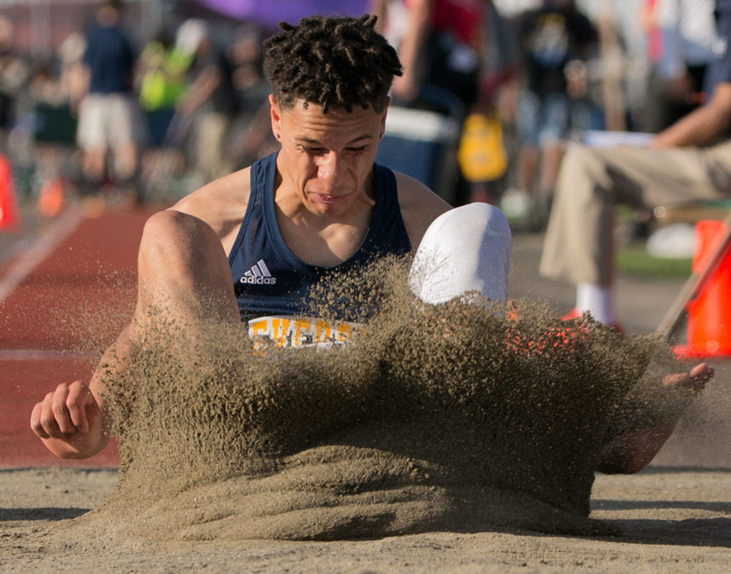 Everett's Elijah Ross-Rutter competes in the triple jump event Thursday at the WIAA track and field state championships at Mount Tahoma High School in Tacoma. (Kevin Clark / The Herald)