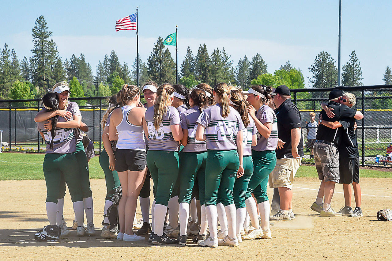 Jackson players celebrate a 6-3 win over Monroe in the 4A state softball championship game on May 26, 2018, at Merkel Sports Complex in Spokane. (Bridget Mayfield/Pescado Lago Studios)