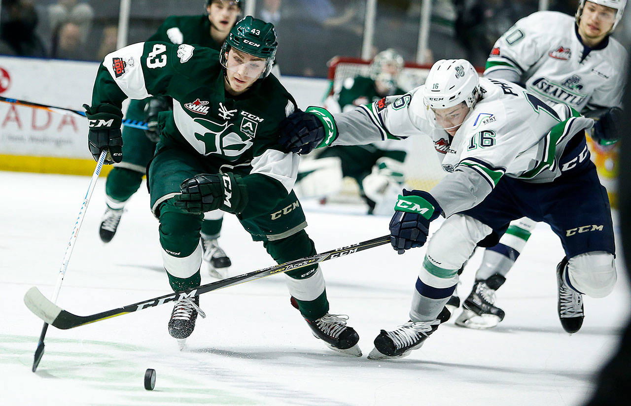 The Silvertips' Connor Dewar (left) battles for the puck with Seattle's Noah Philp during a playoff game on March 27, 2018, in Kent. (Ian Terry / The Herald)