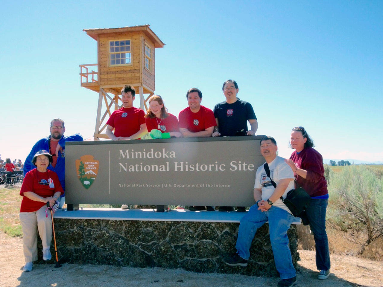 Members of the extended Watanabe family gather at the entrance to the Minidoka National Historic Site in southern Idaho. From left are Shizue Watanabe, Bif Brigman, Lucas Watanabe, Hannah Serl, Ben Watanabe, Dale Watanabe, Glen Watanabe, and Jody Serl. (Glen Watanabe)