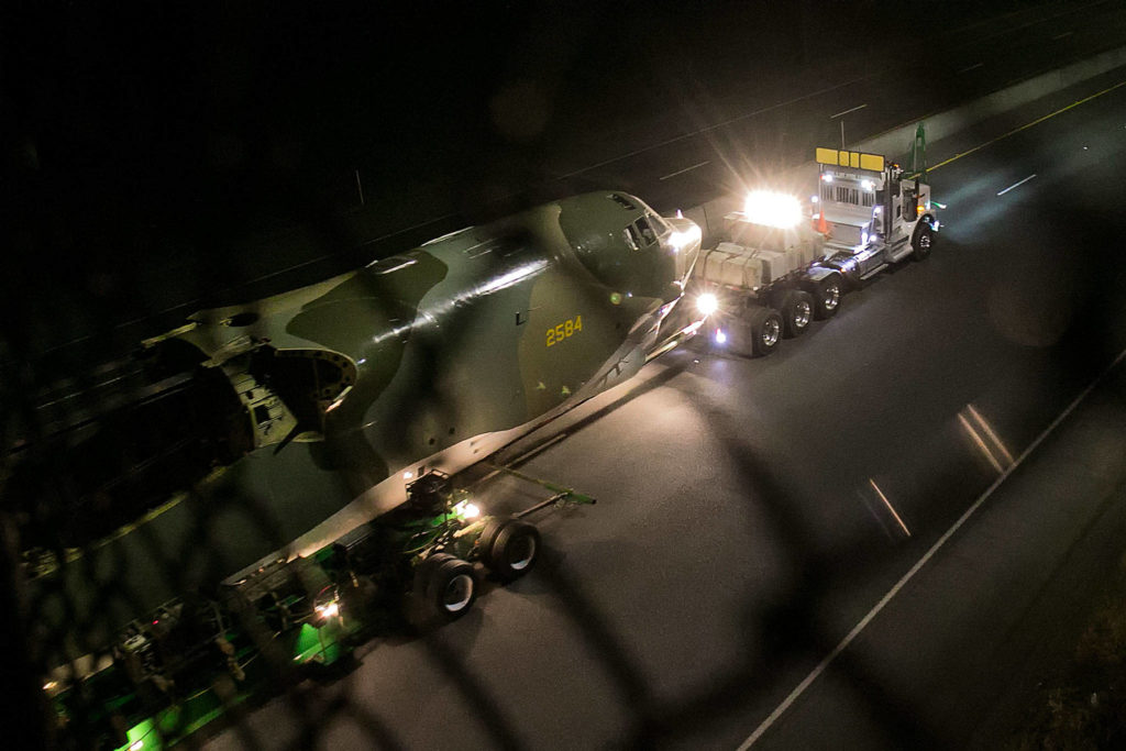 "The B-52 ""Midnight Express"" is towed along Highway 525 from Paine Field en route to Boeing Field in Seattle early Sunday morning. (Kevin Clark / The Herald)"