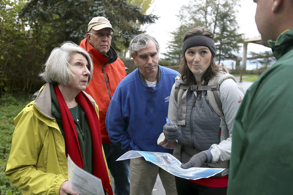 Area residents Joan Smith, (L-R) Gregg Lungren, Mike Gold and Emily Mydynski talk with Todd Zackey over the proposed high density development and the effects on the existing stream and erosion at Picnic Point County Park in Edmonds on Nov. 6, 2015. (Kevin Clark / Herald file)
