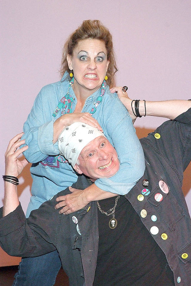 """Angry housewife Carol (Jenny Price) takes out her aggression on club owner Lewd Fingers (Christopher Bartness) in """"Angry Housewives."""" (Photo by Kenny Randall)"""