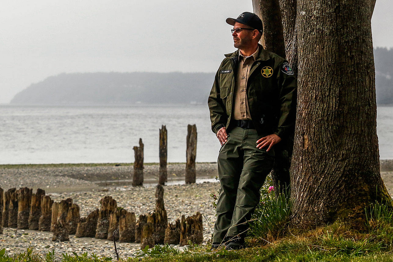 Snohomish County's parks operations supervisor, Rich Patton, has loved parks almost since he was born. When he was a boy, his dad was caretaker here at Picnic Point Park. Once, Rich helped him build a picnic table from logs. It sat near this grassy spot by the beach. (Dan Bates / The Herald)
