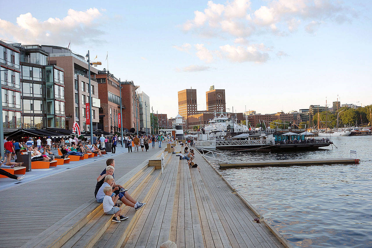 Oslo's harbor, dominated by a shipyard until the mid-1980s, is now the upscale Aker Brygge waterfront neighborhood and hangout zone. (Rick Steves' Europe)