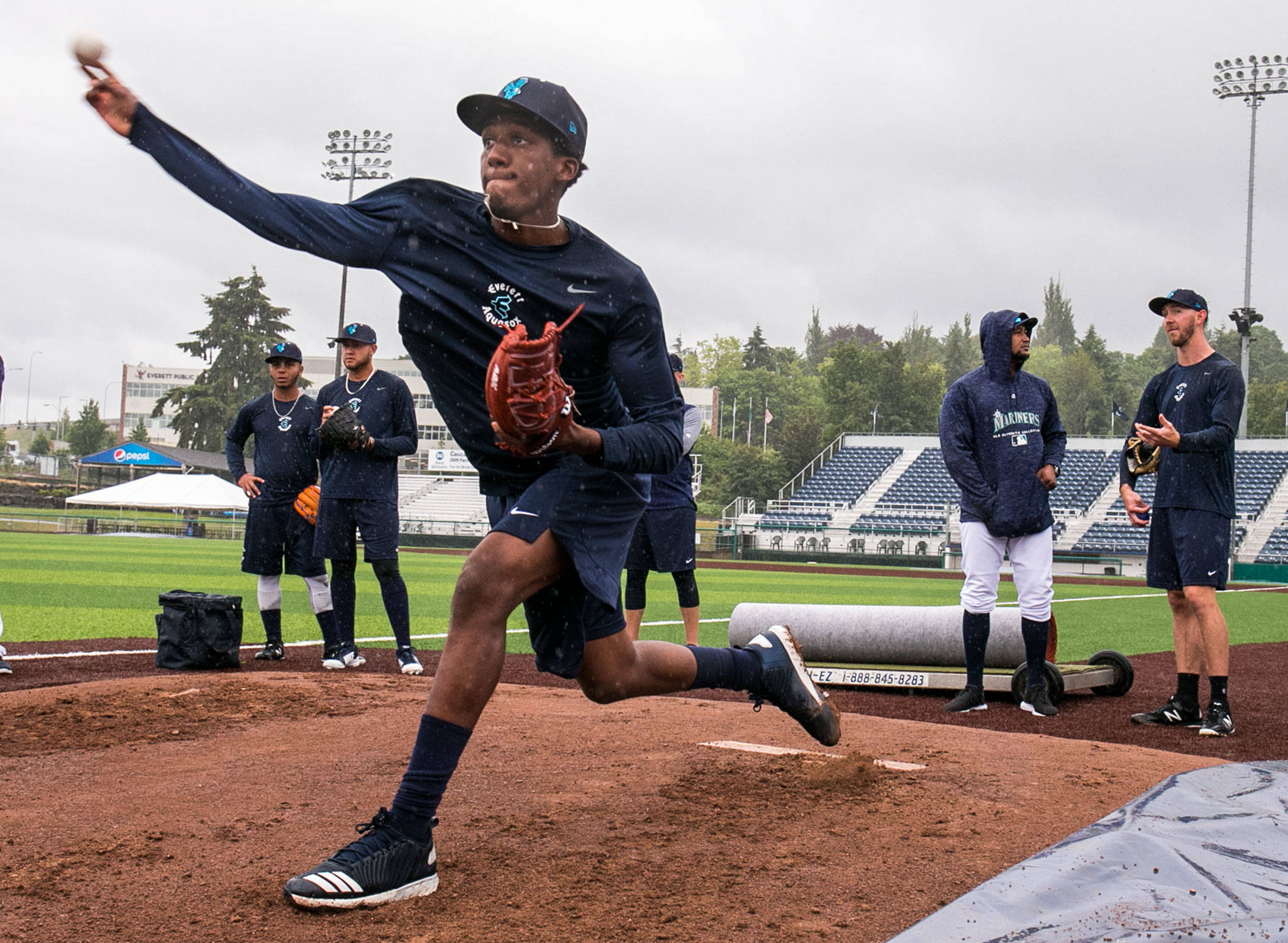 Dayeison Arias throws a pitch during practice at Everett Memorial Stadium in Everett Wednesday afternoon on June 12, 2018. (Kevin Clark / The Herald)