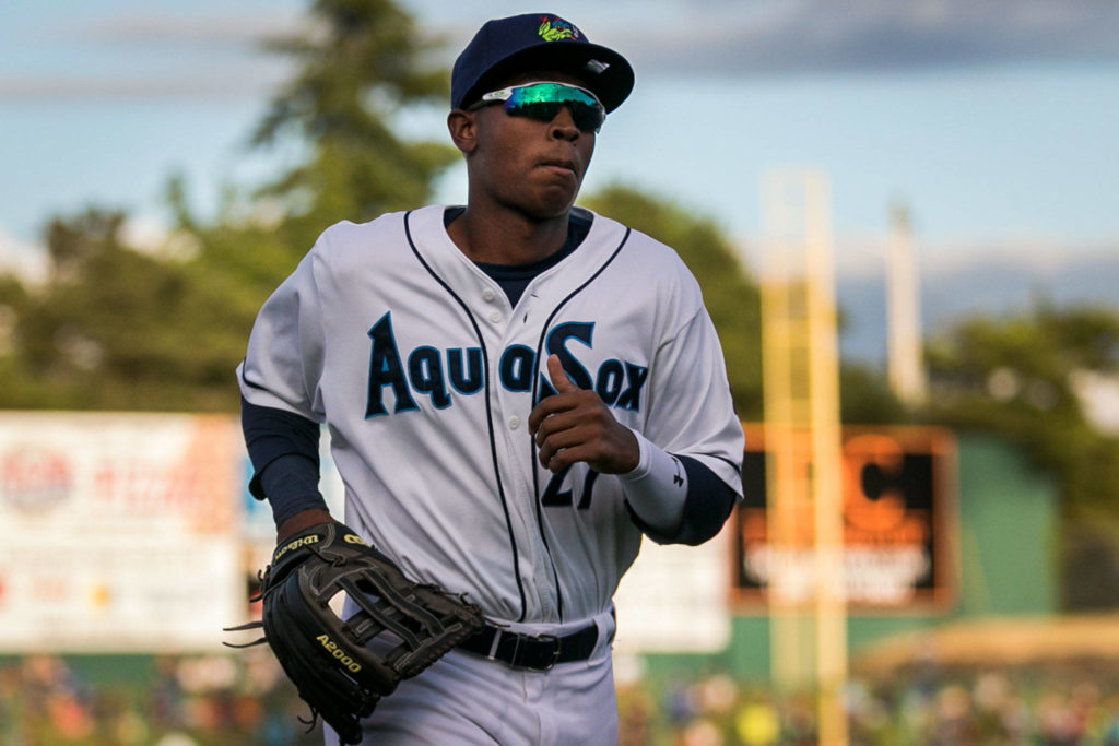 Everett's Ronald Rosario runs to the AquaSox dugout during Friday's game at Everett Memorial Stadium. (Kevin Clark / The Herald)