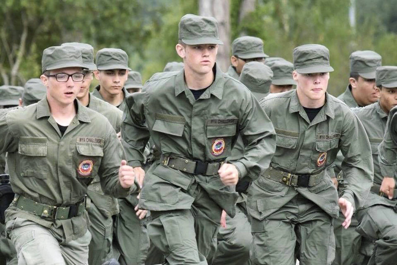 At first Dylan Beakley (center) was a reluctant cadet at the Washington Youth Academy where he was eager to make up lost high school credits. He later became a leader and gave a commencement speech at graduation earlier this year. (Photo courtesy of the Washington Youth Academy)