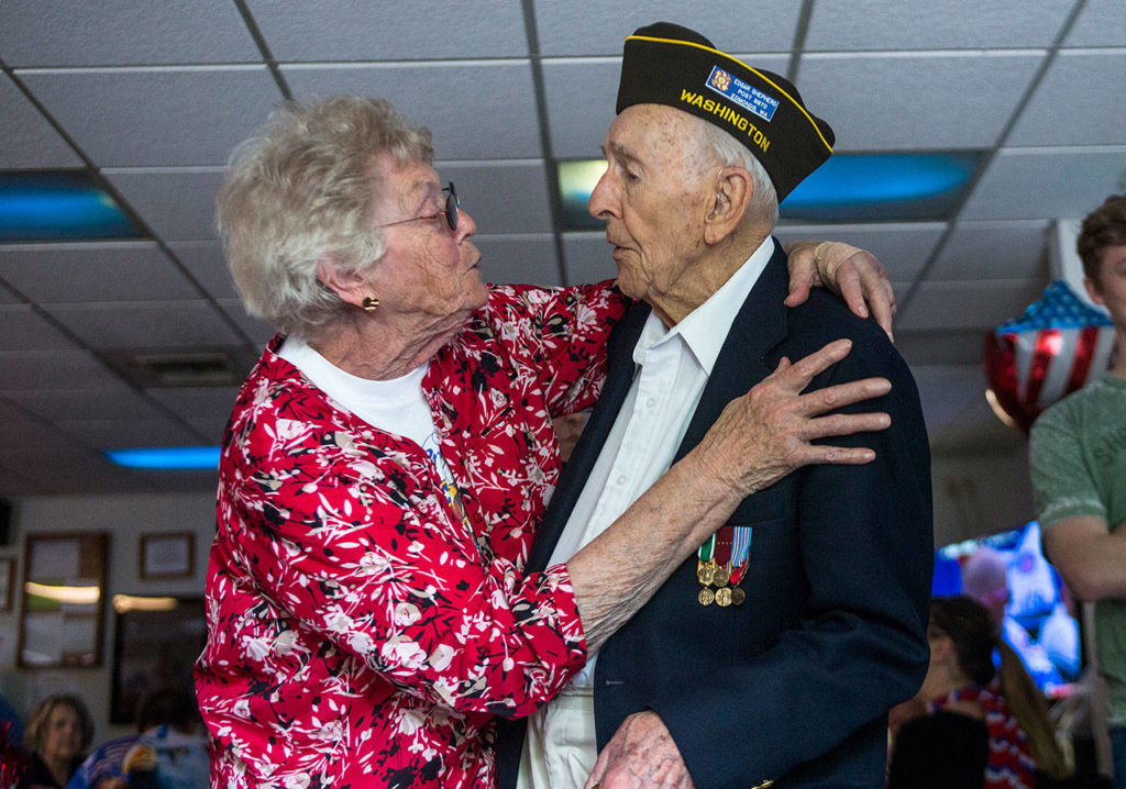 Brenda Passeau (left) hugs Edgar Shepherd at his 100th birthday celebration at the Lynnwood Elks Lodge on Wednesday. (Olivia Vanni / The Herald)