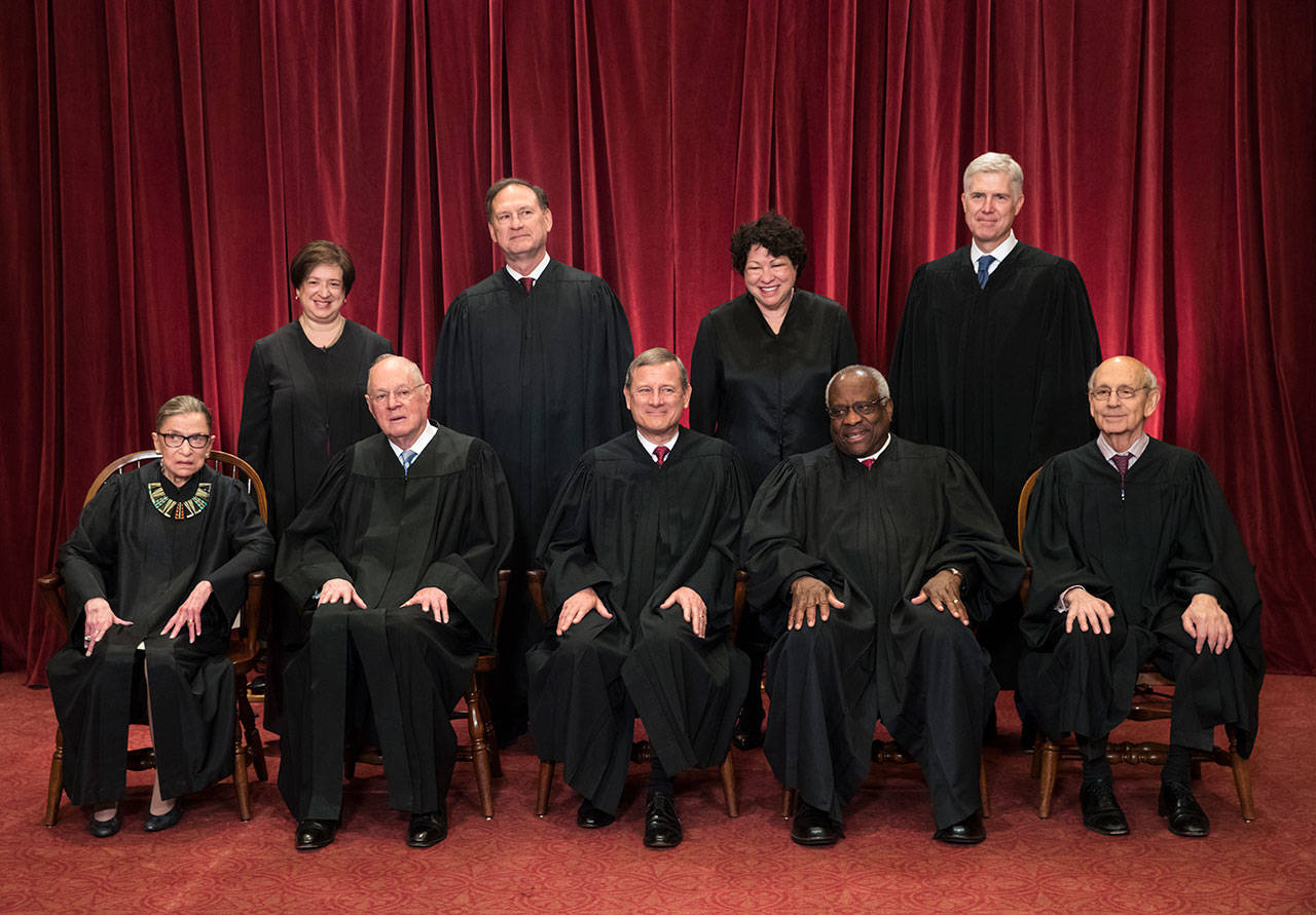 The justices of the U.S. Supreme Court gather for an official group portrait in June 2017. Seated, from left are Associate Justice Ruth Bader Ginsburg, Associate Justice Anthony Kennedy, Chief Justice John Roberts, Associate Justice Clarence Thomas, and Associate Justice Stephen Breyer. Standing, from left are, Associate Justice Elena Kagan, Associate Justice Samuel Alito Jr., Associate Justice Sonia Sotomayor, and Associate Justice Neil Gorsuch. The 81-year-old Kennedy said Tuesday that he is retiring after more than 30 years on the court. (J. Scott Applewhite/Associated Press File)