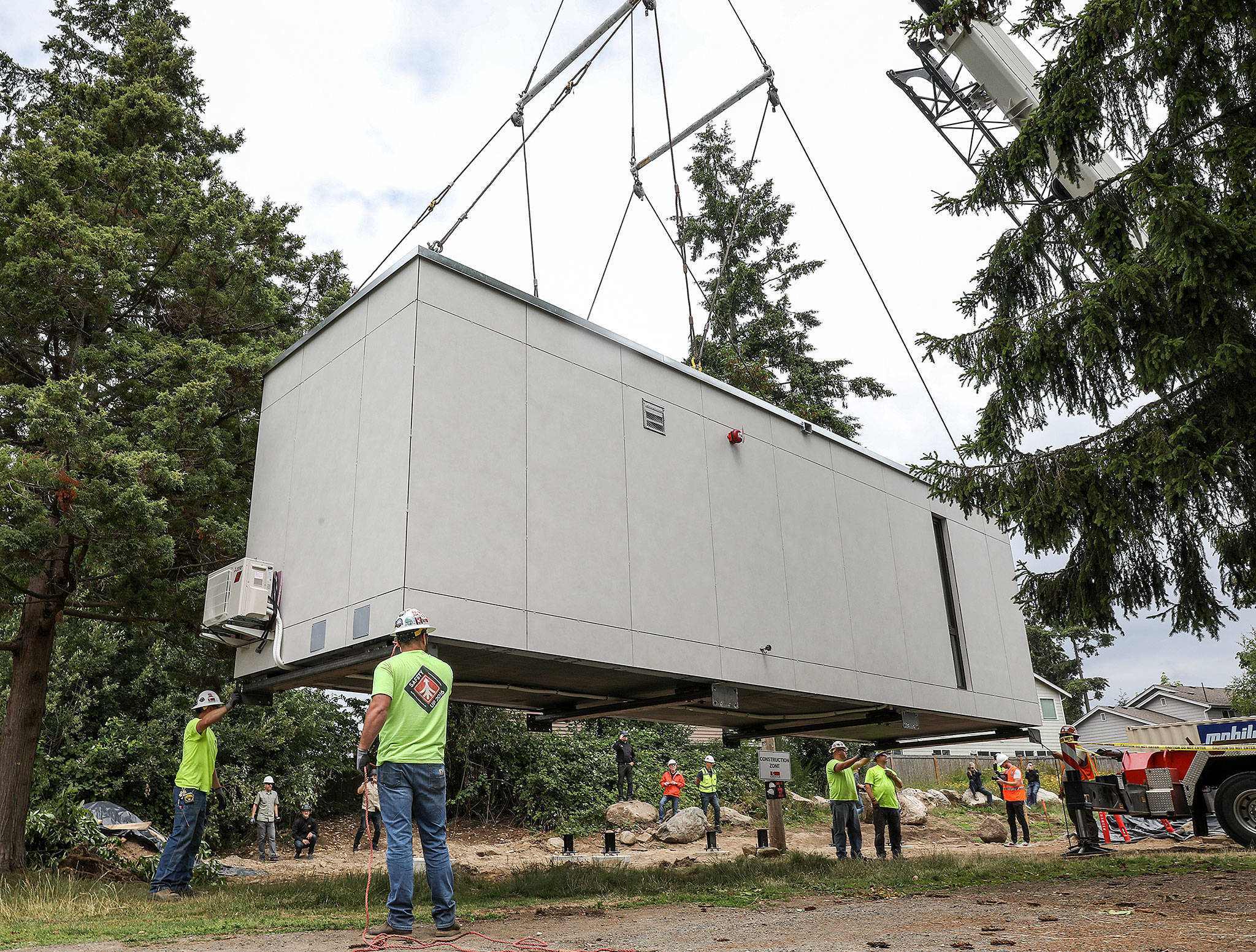 The first Blok unit by the start-up Blokable is placed on the grounds of the Edmonds Lutheran Church on June 29. The church is partnering with Compass Housing Alliance to build low-income housing on its property. (Lizz Giordano / The Herald)