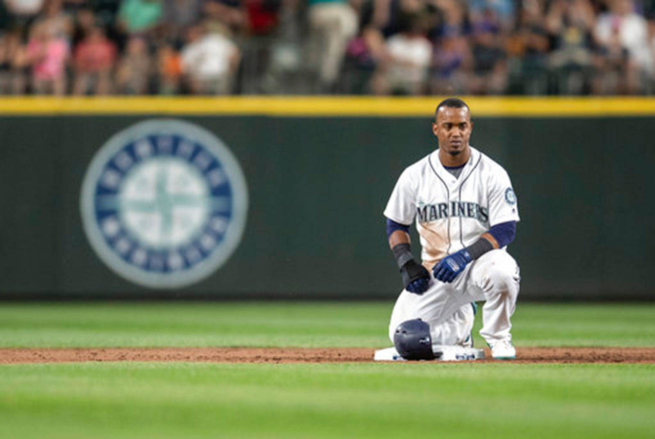 Jean Segura of the Seattle Mariners kneels on second base during a pitching change in Thursday's game against the Los Angeles Angels at Safeco Field in Seattle. (AP Photo/Stephen Brashear)