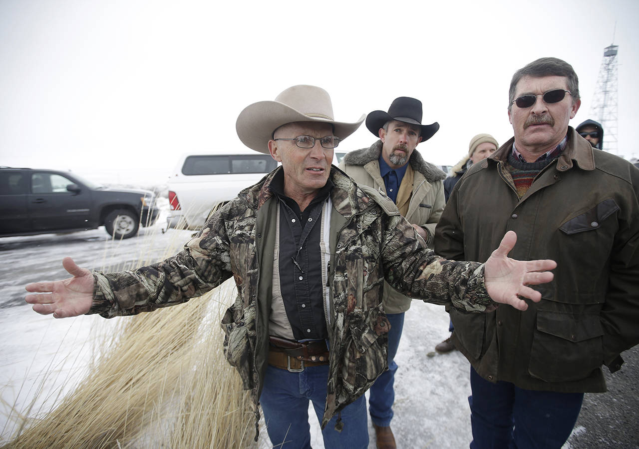 "In this Jan. 9, 2016 photo, Robert ""LaVoy"" Finicum (left), a rancher from Arizona, talks to reporters at the Malheur National Wildlife Refuge near Burns, Oregon. Finicum was among those occupying the refuge in protest against the sentences of two ranchers convicted of arson on public land. Finicum was killed during the standoff with police. (AP Photo/Rick Bowmer, File)"