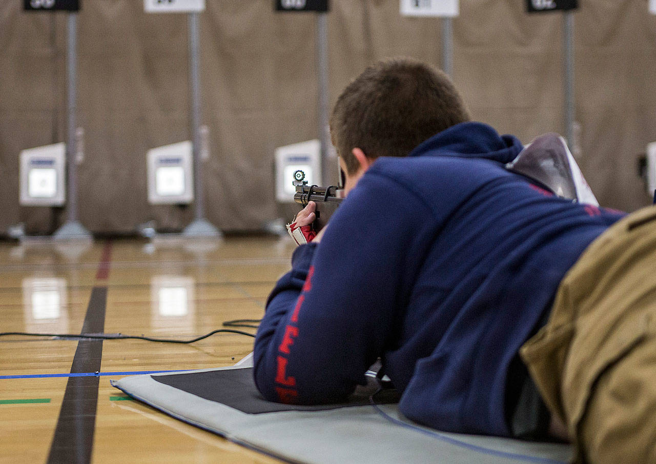 Hunter Pyeatt lines up his sight with the target during CMP Air Rifle Marksmanship Camp at Snohomish High School on Thursday, July 12, 2018 in Snohomish, Wa. (Olivia Vanni / The Herald)
