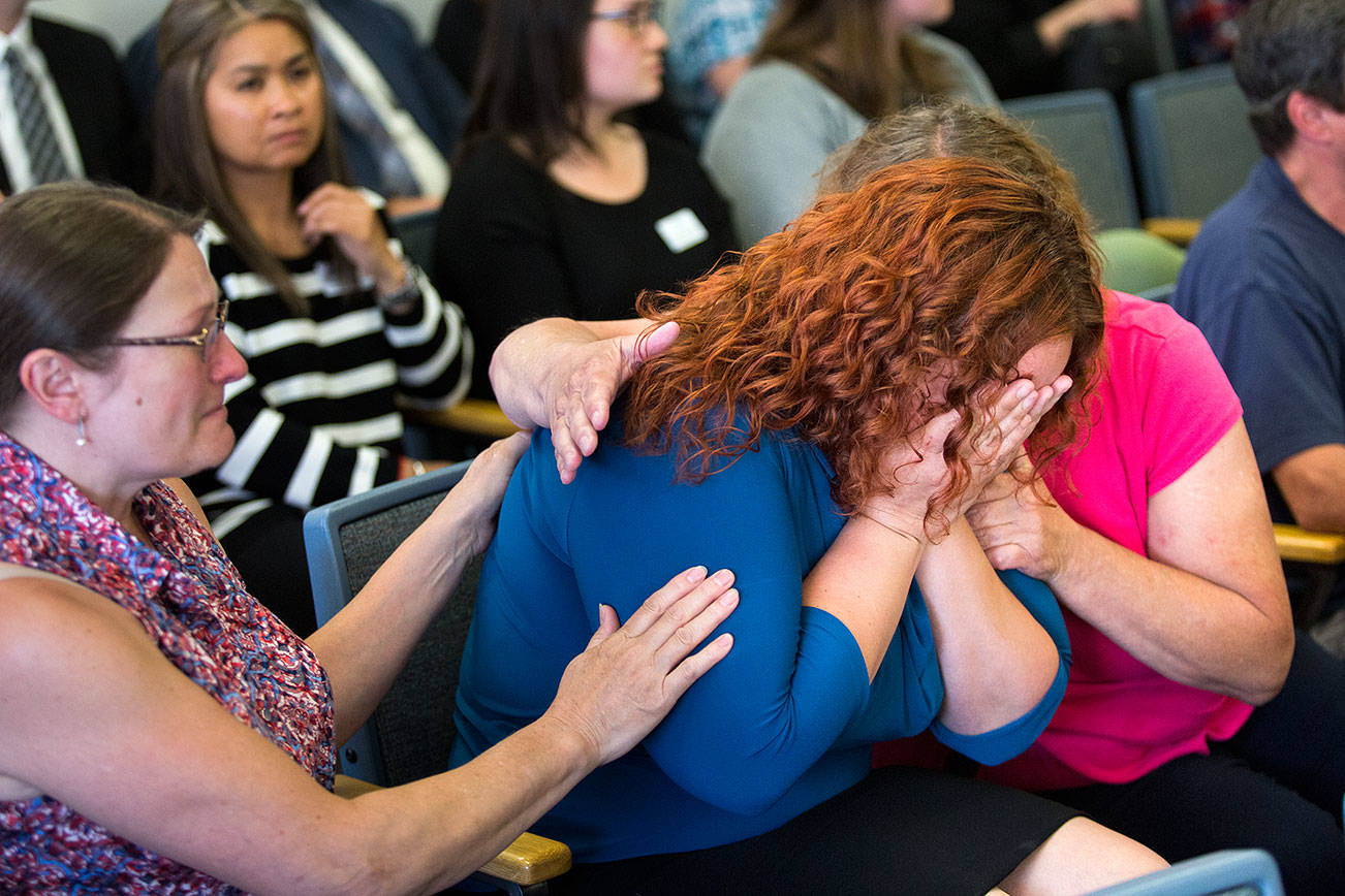 Melissa McCawley is comforted by relatives after hearing that Todd Eugene Brown, 52, is found not guilty at the Snohomish County Courthouse on Thursday in Everett in the deaths of her daughter, Amiyah Johnson, 12, and her niece, Yesterday Wallace, 2. A judge found Brown not guilty of being impaired by methamphetamine when a crash killed the two cousins on I-5 near Lynnwood, even though his blood tested positive for drugs. (Andy Bronson / The Herald)