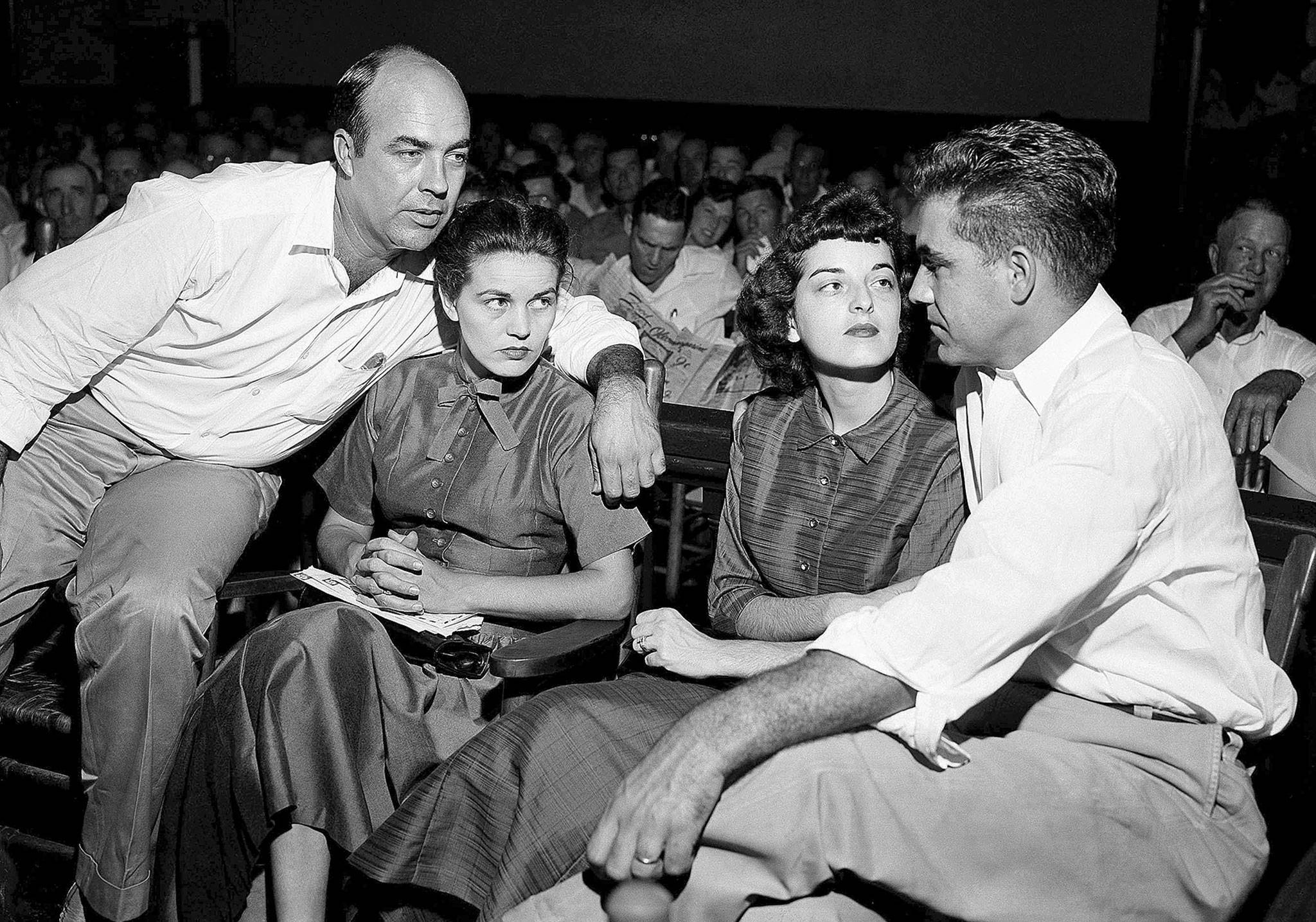 "From left: J.W. Milam, his wife, Carolyn Bryant and her husband, Roy Bryant, in a courtroom in Sumner, Mississippi, on Sept. 23, 1955. Roy Bryant and his half-brother, Milam, were charged with murder but acquitted in the kidnap-torture slaying of 14-year-old black teen Emmett Till after he allegedly whistled at Carolyn Bryant. The men later confessed in a magazine interview but weren't retried; both are now dead. Citing ""new information,"" the U.S. Justice Department has reopened the investigation into Till's death. (AP Photo, File)"