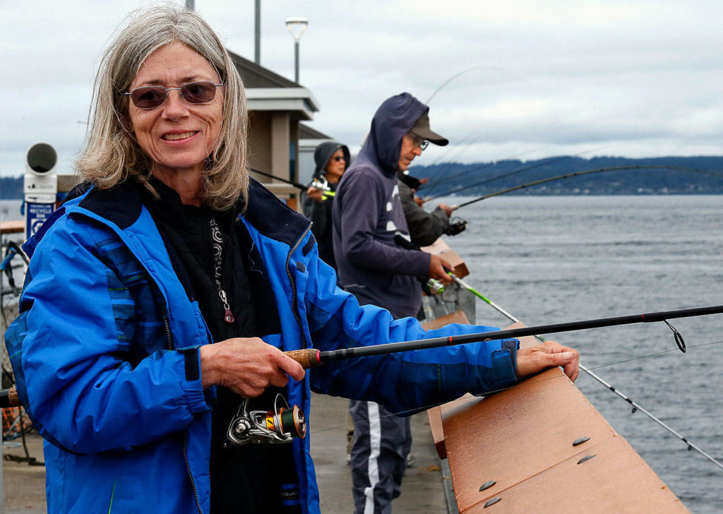 Valeda King loves to fish. She spends up to five hours a day at the public pier in Edmonds. (Dan Bates / The Herald)