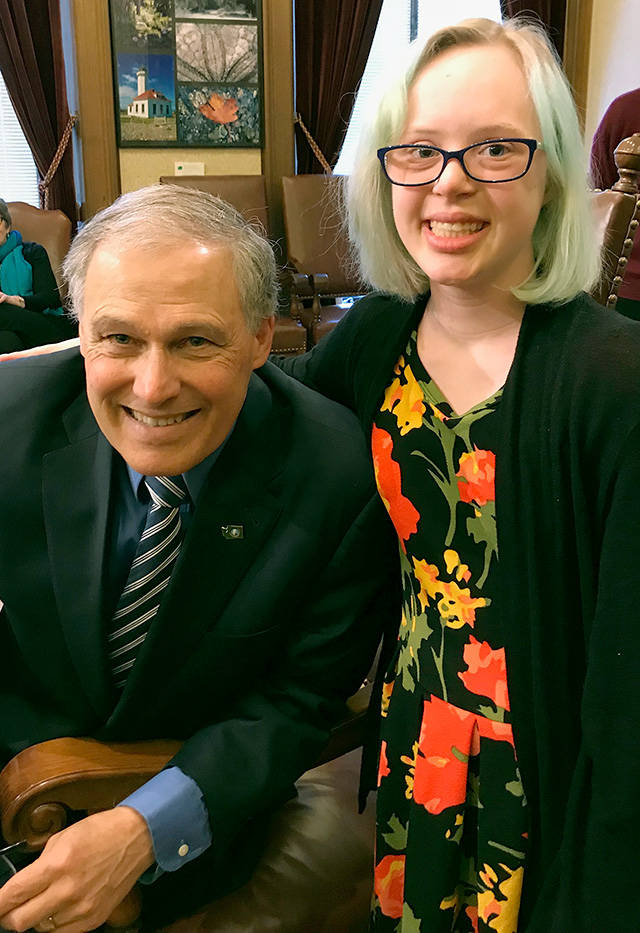 Emma Patterson, 16, poses with Gov. Jay Inslee while she and her mother, Amy Patterson (not pictured), were in Olympia to testify about the Achieving a Better Life Experience legislation. ABLE allows people with disabilities to save money in a tax-exempt account without losing public benefits such as Medicaid. (Courtesy of Amy Patterson)