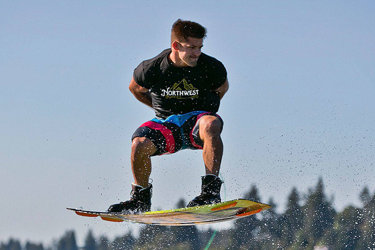 Everett native Chad Douglas rides his wakeboard on Lake Washington. (Photo by Rob Adams)
