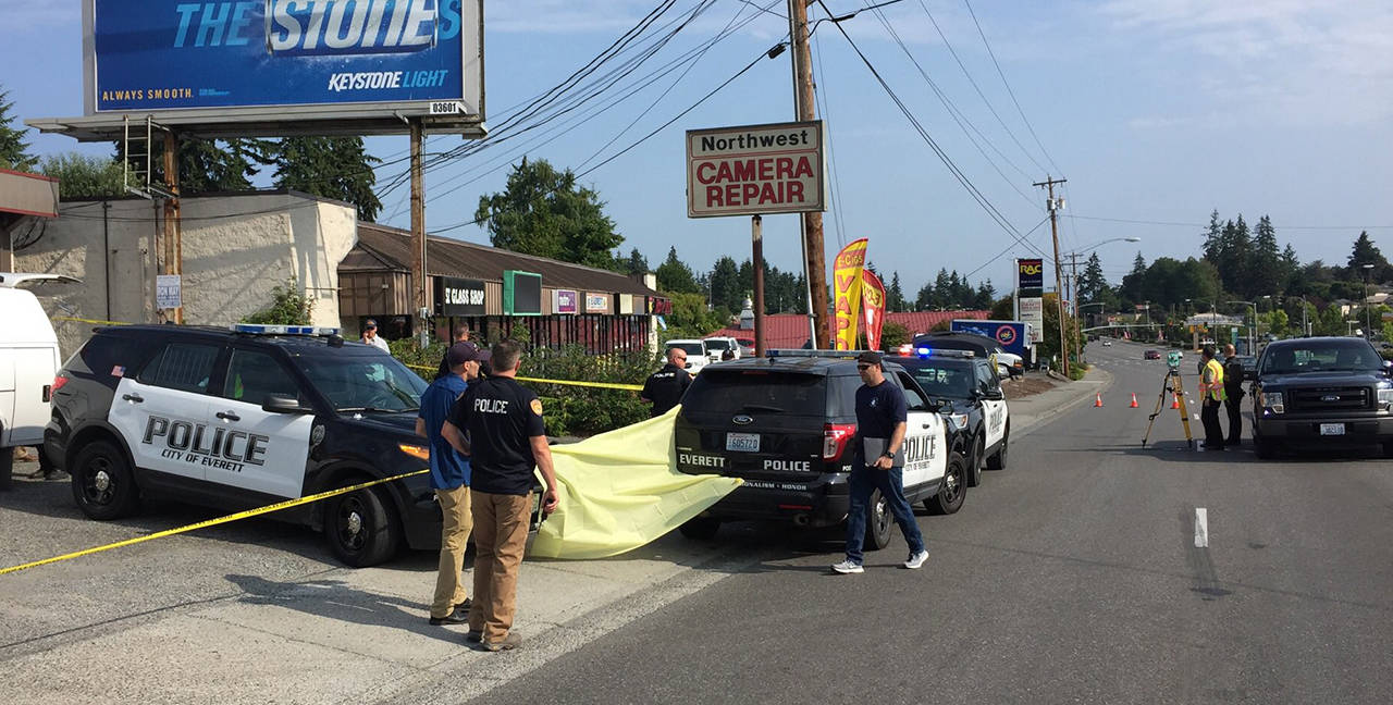 A homicide investigation was ongoing Saturday after a man's body was found in a parking lot on Evergreen Way. (Everett police)