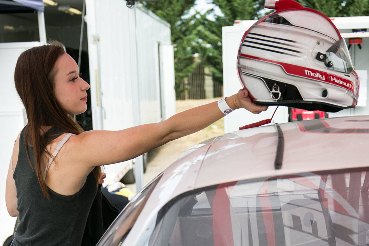 Molly Helmuth prepares for time trials on July 28 at Evergreen Speedway in Monroe. (Kevin Clark / The Herald)