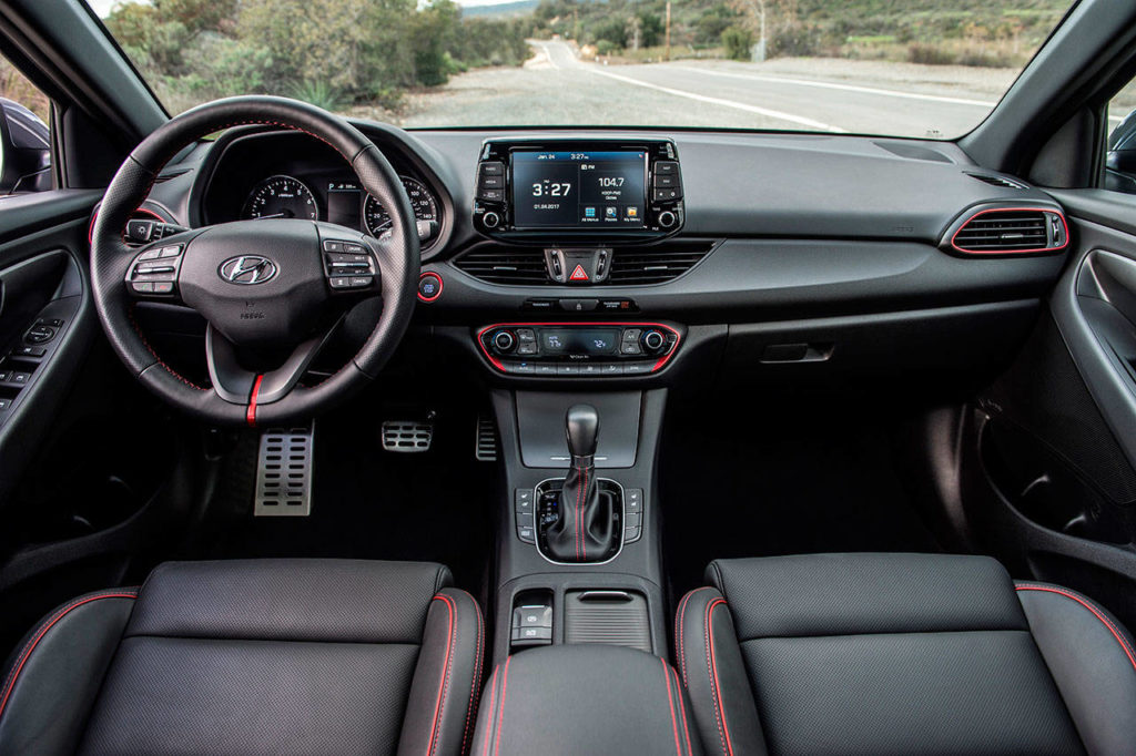 The 2018 Hyundai Elantra GT interior includes a generous assortment of stowage spaces. (Manufacturer photo)