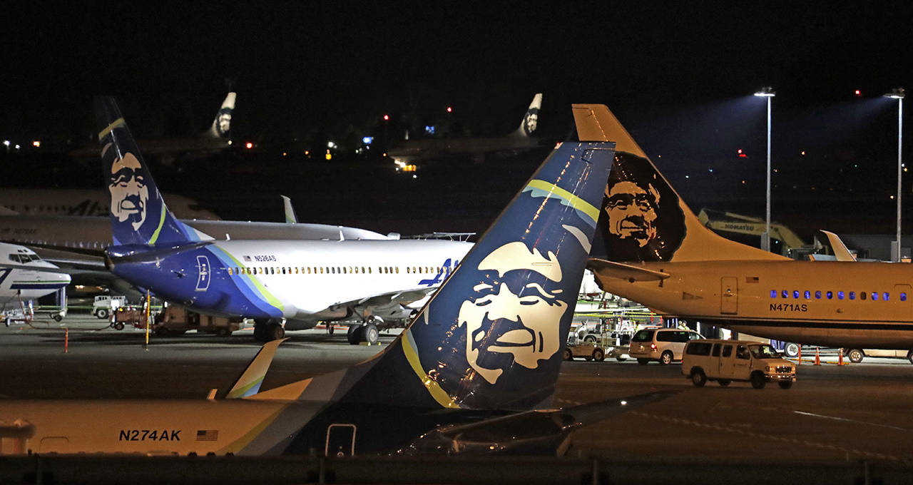 Alaska Airlines planes sit on the tarmac at Sea-Tac International Airport Friday evening, Aug. 10, in SeaTac. (AP Photo/Elaine Thompson)