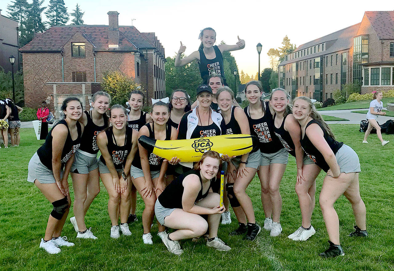 Granite Falls High School enjoyed a day as Top Banana at a recent cheer camp, and at the end of the camp came home with four trophies. (Contributed photo)