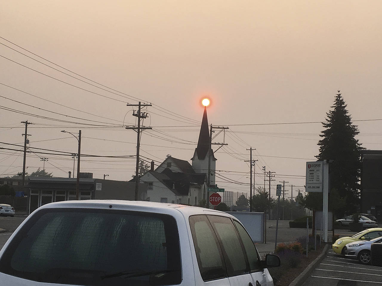 Sue Misao / The Herald                                The sky is likely once again to look like this, when the sun rose Wednesday over Calvary Lutheran Church in Everett.