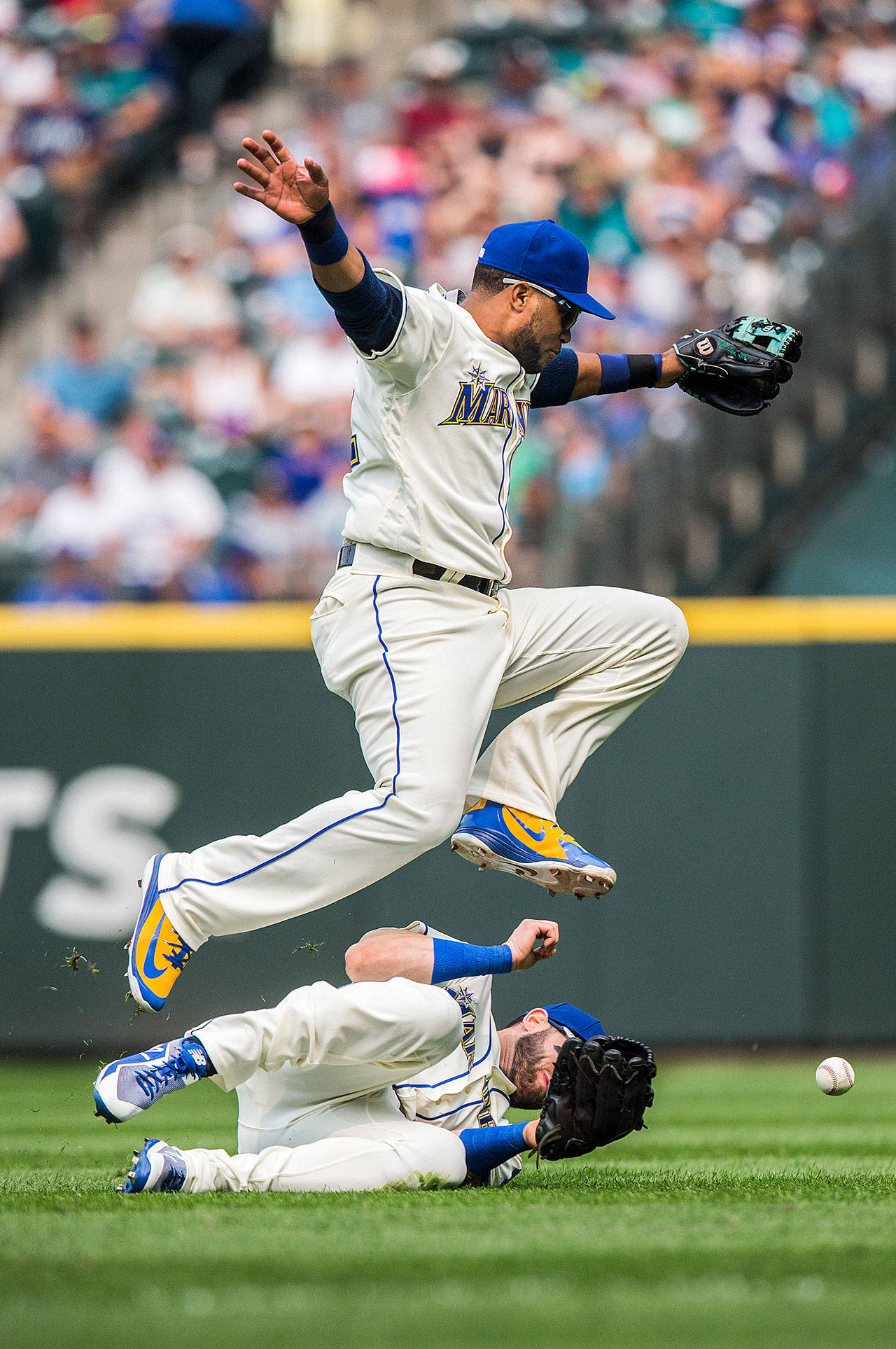 Seattle second baseman Robinson Cano jumps over teammate Mitch Haniger during Sunday's game against the Los Angeles Dodgers at Safeco Field in Seattle. The Mariners lost to the Dodgers, 12-1. (Olivia Vanni / The Herald)